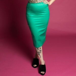 Tattooedd model wearing green pin up tight high waist pencil skirt with pockets, vintage pencil skirts