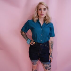 Blonde haired woman in Rockabilly Clothing