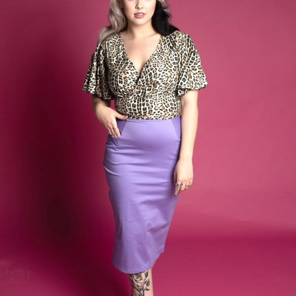 Tattooed model wearing lilac pinup tight high waist pencil skirt with pockets, and leopard print blouse. vintage pencil skirts, eco fashion, sustainable fashion