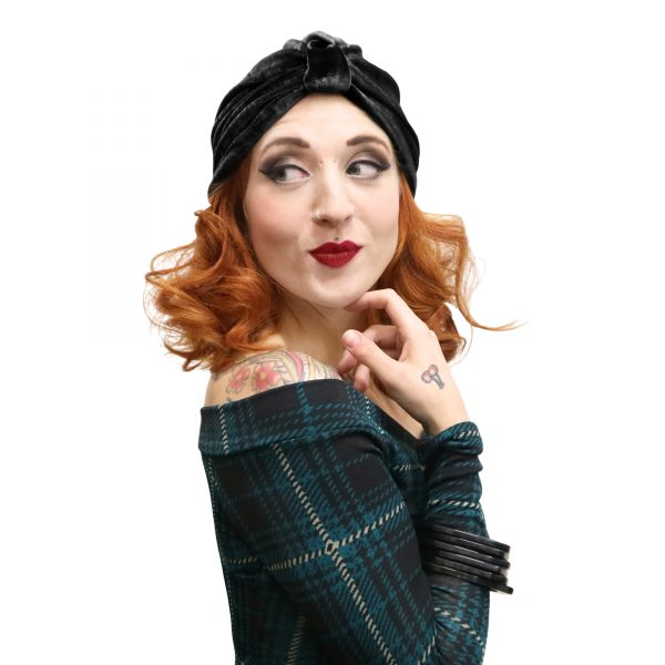 Fits the bill of a vintage witch. Black velvet 40s style pin up turban