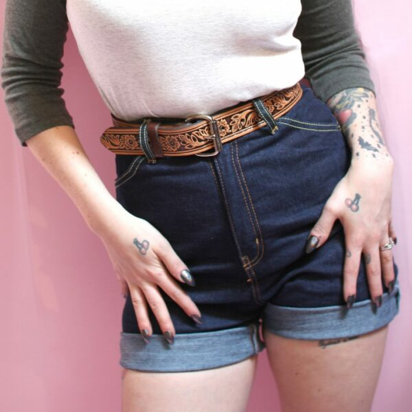 High waisted blue denim shorts with brown belt