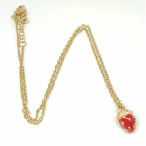 Gold tone chain necklace with a enamel strawberry charm