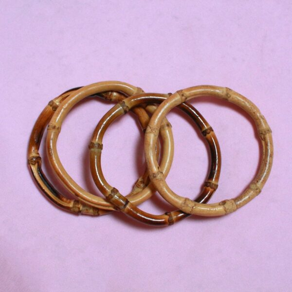 three textured brown and tan wooden bamboo bangles - sustainable, eco fashion. Bamboo bangle Jewellery to stack