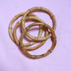 set of four textured brown and tan wooden bamboo bangles - sustainable, eco fashion. Bamboo bangle Jewellery to stack
