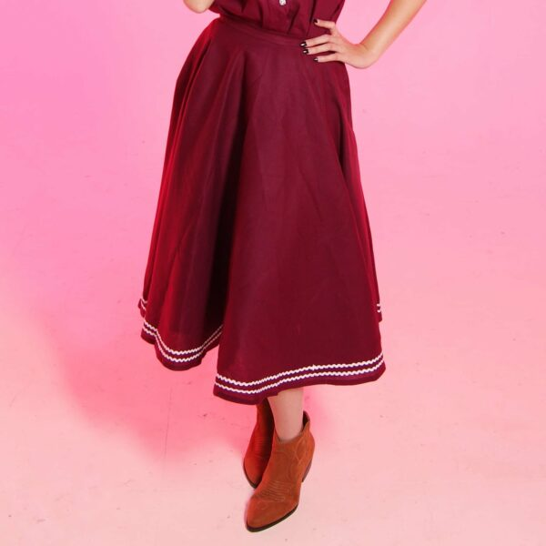vintage pinup style darling circle skirts with pockets in burgundy cotton with white trim from eco friendly, sustainable fashion brand lady k love against pink background circle skirts