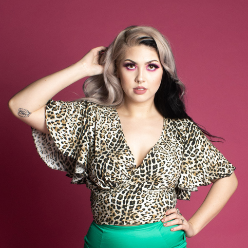 Alternative retro pin up model wearing vintage styled leopard print wrap top.