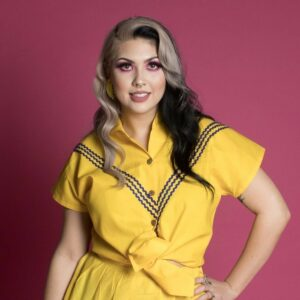 Woman in yellow rockabilly pin up top