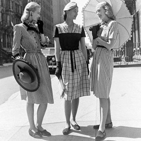 black and white image of three women wearing vintage 50s rockabilly dresses in New York
