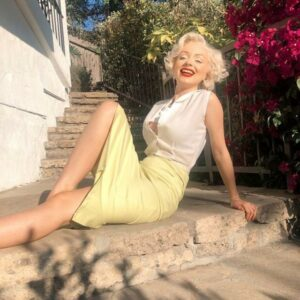 Pin up girl, Marylin Monroe lookalike. wearing a red lip and lady k loves skirt, and smiling