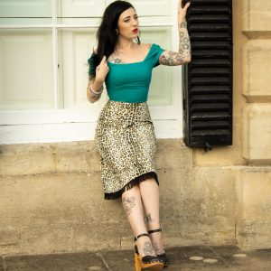 Tattooed modern pin up wearing retro uk pin up vintage clothing